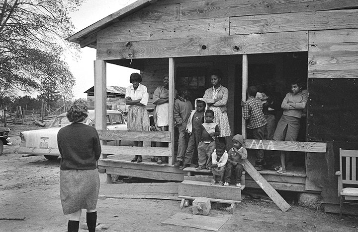An African-American family in the South gathers to speak with a northern college student about the Mississippi Freedom Christmas – a mission to enroll African-American voters following the Voting Rights Act of 1965.