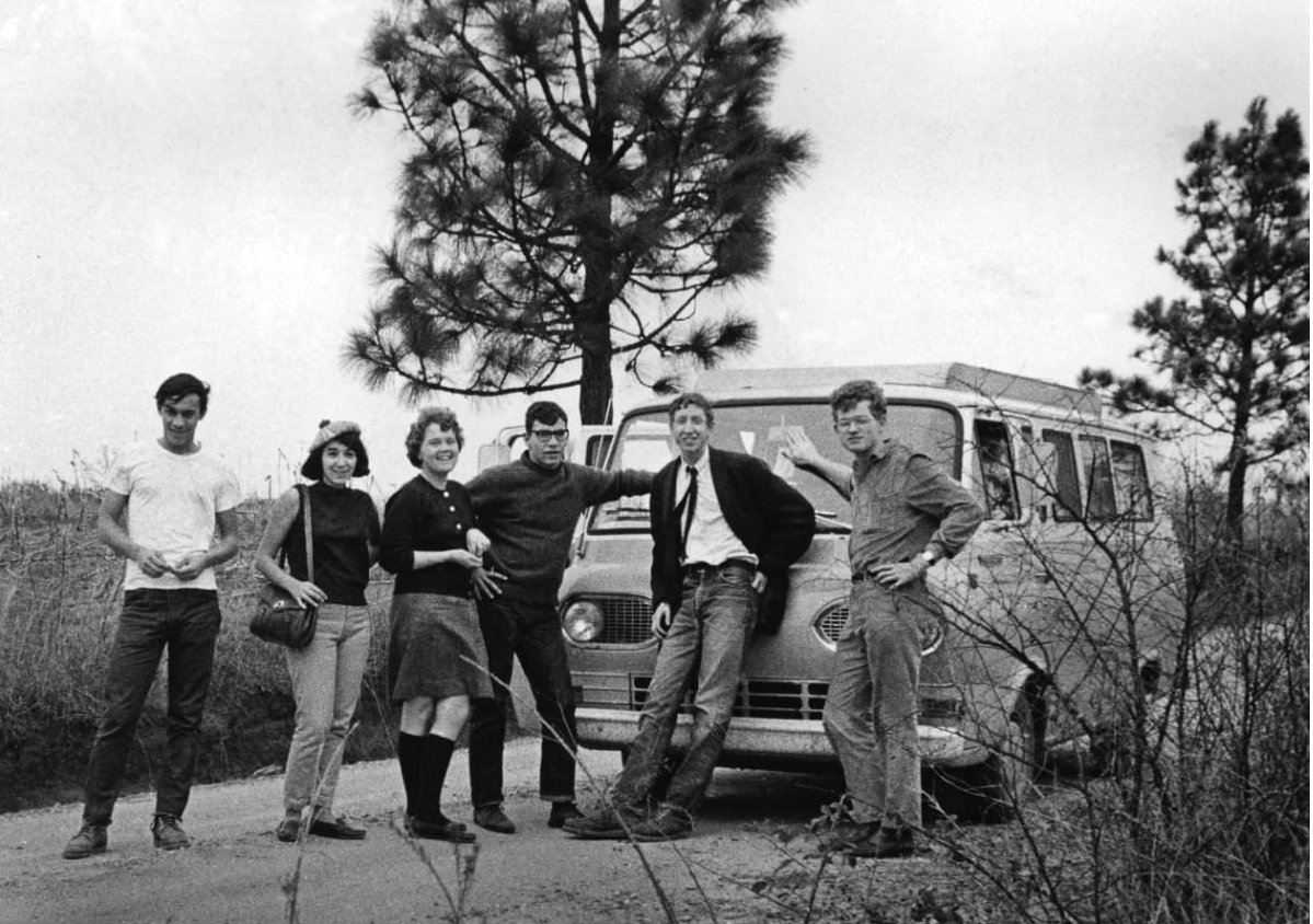 Jim Lemkin, second from the right, and his group pose for a photo in front of the van they drove from New York to Mississippi in 1965.